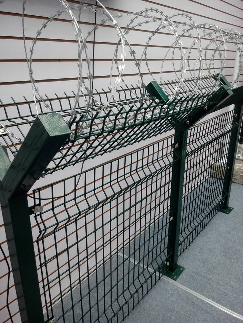 a pvc coated welded wire fence in dark green with yshaped post and on10 wire