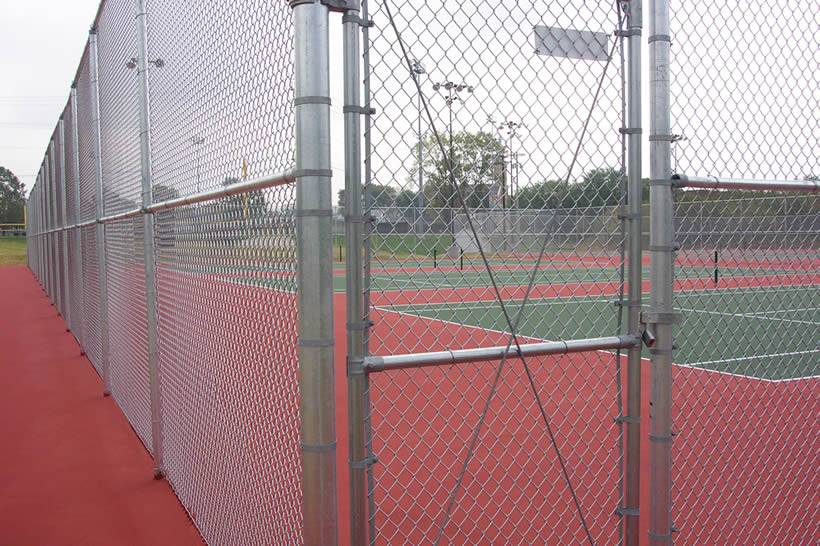 galvanized chain link fence is used as fencing for sports field