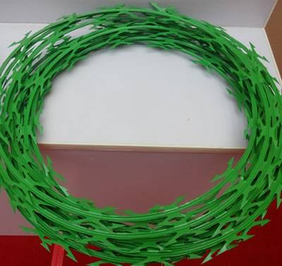 A coil of PVC coated razor wire in green color.