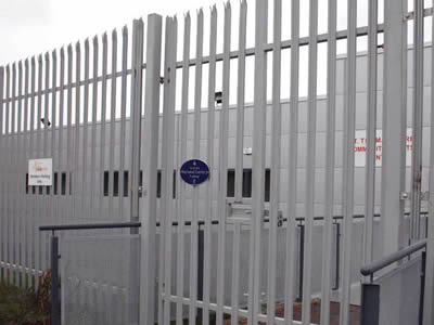A white PVC coated gate fence is used to surround a white-wall factory.