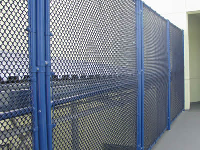 A blue mini chain link security fence is installed on the road to protect personal safety and property.