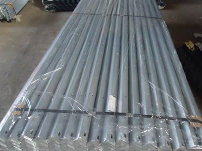 A pile of rails of palisade fencing packaged by two strings is in plastic film.